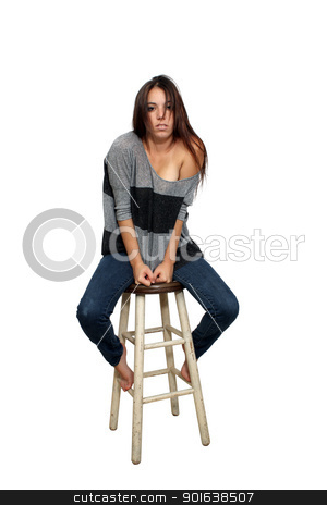 Casual Brunette on a Barstool (5) stock photo, A lovely young brunette in casual wardrobe sits on a barstool, isolated on a white background with generous copyspace. by Carl Stewart