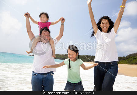 happy asian family jumping on the beach stock photo, happy asian family jumping on the beach by tomwang