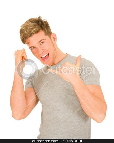 Young man making hang loose hand signals stock photo, Young man making hang loose hand signals by ambrophoto