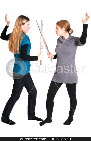 Rivalry stock photo, Rivalry between two young women with transverse flute isolated on white background. by www.ericfahrner.com