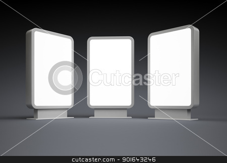 Three bright lit, blank vertical billboards stock photo, Three bright lit, blank vertical billboards at night by Mopic