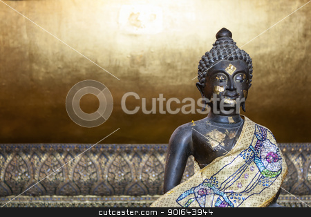 Small Buddha Bronze stock photo, Small Buddha Bronze Age sit background gold by cookiecutter