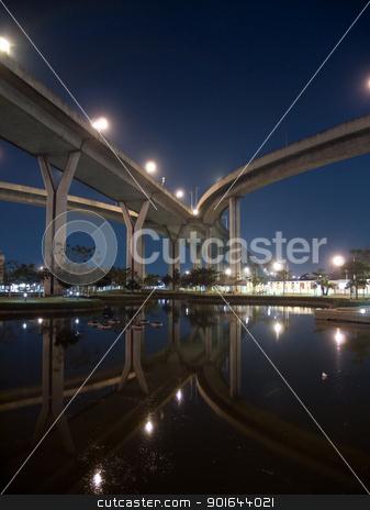 Part of Bhumibol Bridge stock photo, Bhumibol Bridge also casually call as Industrial Ring Road Bridge at night scene with reflection, Samut Prakarn,Thailand by Exsodus