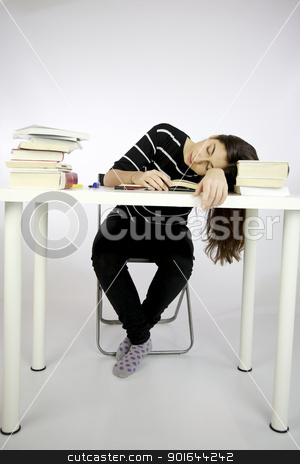 Girl sleeping while studying sitting  stock photo, Girl sleeping while studying sitting in front of a desk full of books by federico marsicano