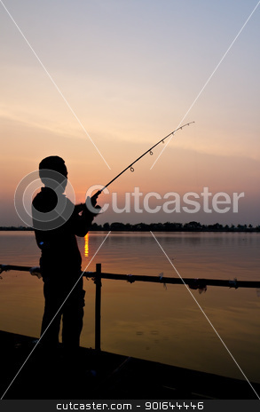 Silhouette of a man fishing stock photo, Silhouette of a man fishing with a beautiful lake background at sunset by stoonn