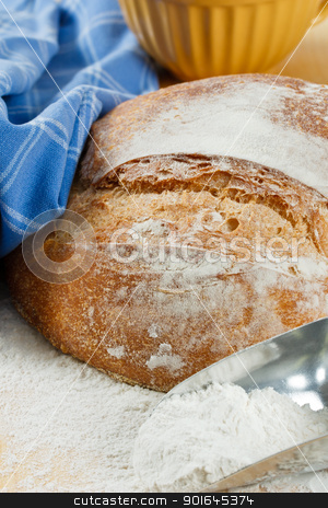 Crusty Artisan Bread With Wheat Flour stock photo, Close up of fresh baked artisan bread with enriched wheat flour in foreground by Karen Sarraga