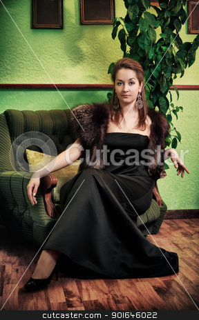 Beautiful Lady Sitting in Armchair stock photo, young beautiful lady sitting in armchair at luxury interior by Petr Malyshev