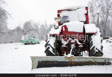 old russian soviet tractor covered snow in winter  stock photo, old russian soviet tractor covered with snow in winter. retro vintage machinery adapted to snow plowing.  by sauletas