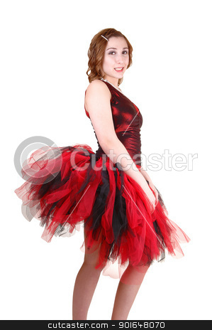 Young ballet girl. stock photo, A young pretty teenager in a red and black ballet outfit with a big twill skirt standing in profile for white background in the studio.  by Horst Petzold