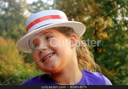 Little girl wearing 4th of July hat and smiling stock photo, Little girl wearing 4th of July hat and smiling by Shirley Mathews