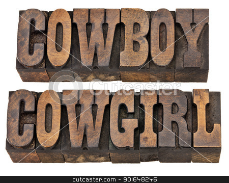 cowboy and cowgirl isolated words stock photo, cowboy and cowgirl - isolated words in vintage letterpress wood type, French Clarendon font popular in western movies and memorabilia by Marek Uliasz