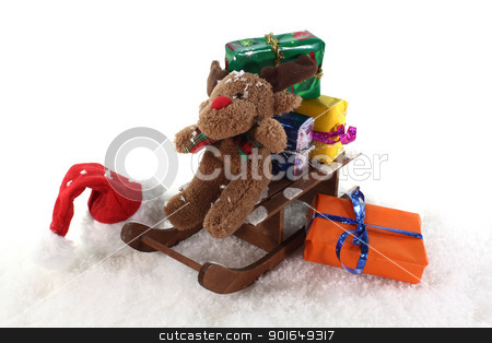 sleigh with gifts stock photo, Santa Claus hat and sleigh with gifts and a elk by Maren Wischnewski