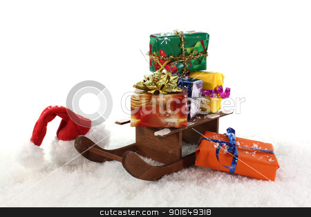 sleigh and christmas gifts stock photo, Santa Claus hat and slide with colorful gifts by Maren Wischnewski