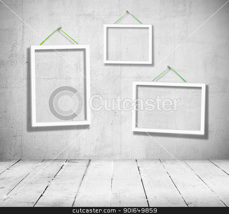 Vintage room stock photo, Three empty wooden frames for paintings hang in black and white vintage room on the wall by Imaster