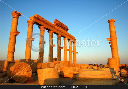 Relics of Palmyra in Syria at sunset stock photo, Relics Palmyra in Syria against blue sky. Ancient Roman time town in Palmyra (Tadmor), Syria. by John Young
