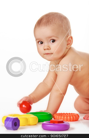 Small child play with toys on white background stock photo, Baby play with toys on white background in studio by Oleg