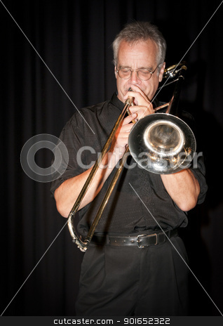 Slide Trombone stock photo, Trombonist Dave Arthur playing at the Art Centre in Ottawa, Canada. by Michel Loiselle