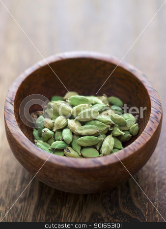 cardamon pods stock photo, close up of a bowl of cardamon pods by zkruger