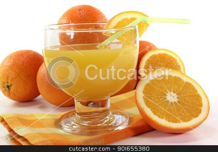orange juice stock photo, freshly squeezed orange juice on a light background by Maren Wischnewski