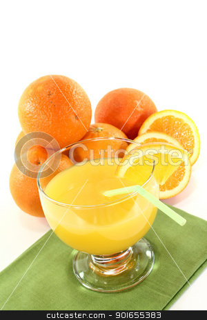 fresh orange juice with orange halves stock photo, glass of freshly squeezed orange juice with orange halves on a light background by Maren Wischnewski