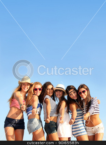 group of teens on beach summer vacation or spring break stock photo, group of teens on beach summer vacation or spring break by mandygodbehear