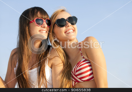 teens on summer vacation or spring break stock photo, teens on summer vacation or spring break by mandygodbehear