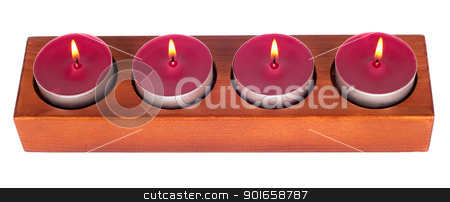Four burning candles stock photo, Wooden candleholder or candlestick with four burning or flaming  candles isolated on white background by borojoint
