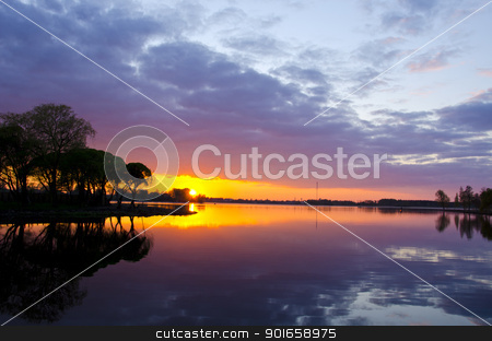 summer lake sunset. Boats sky reflections water  stock photo, Amazing summer lake landscape and sunset colors in evening. Boats in distance. Sky and sun reflections.  by sauletas