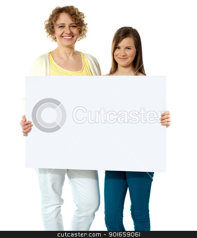 Yor AD Here stock photo, Pretty women posing with blank whiteboard, isolated by Ishay Botbol