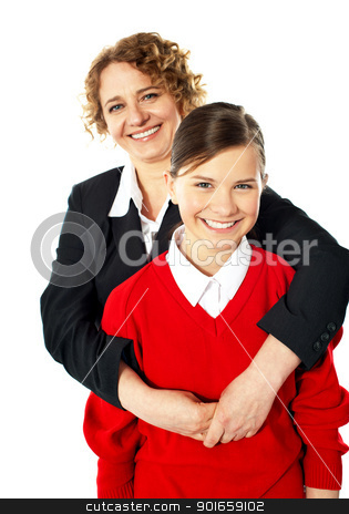 Teacher embracing her student from back stock photo, Teacher embracing her student from back and posing in front of camera by Ishay Botbol
