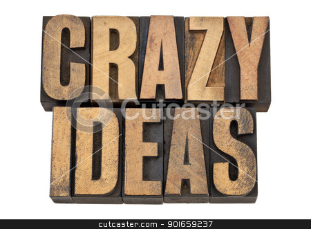 crazy ideas in letterpress type stock photo, crazy ideas - creativity concept - isolated text in vintage  letterpress woodtype by Marek Uliasz