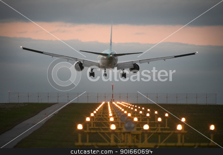 Landing airplane stock photo, Photo of an airplane just before landing. Runway lights can be seen in the foreground. by christless