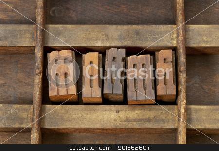 ligature letterpress printing blocks stock photo, ligature - vintage wooden letterpress printing blocks in an old grunge typesetter drawer by Marek Uliasz
