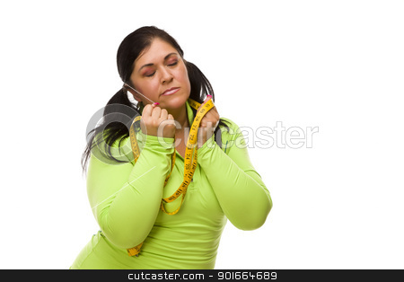 Frustrated Hispanic Woman with Tape Measure stock photo, Attractive Frustrated Hispanic Woman with Tape Measure Against a White Background. by Andy Dean