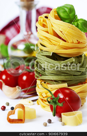 Italian Pasta stock photo, Italian Pasta with tomatoes,  olive oil and basil on a white background by klenova