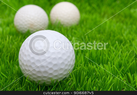 Golf Balls		 stock photo, Group of Golf Balls in Green Grass by JAMDesign