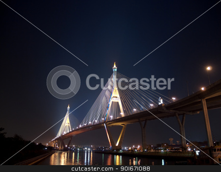 Part of Bhumibol Bridge stock photo, Bhumibol Bridge also casually call as Industrial Ring Road Bridge illuminate with spotlight at night scene, Samut Prakarn,Thailand by Exsodus