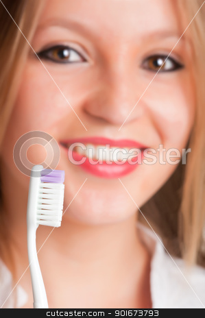 Teeth Brushing stock photo, Closeup of young woman with a tooth brush on her hands, about to brush her teeth by ruigsantos