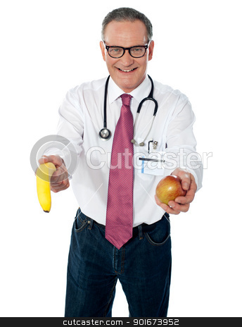 A fruit a day keeps doctor away stock photo, Senior doctor offering fruits to you for your good health by Ishay Botbol