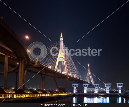 Part of Bhumibol Bridge stock photo, Bhumibol Bridge also casually call as Industrial Ring Road Bridge with floodgate illuminate with spotlight at night scene, Samut Prakarn, Thailand by Exsodus