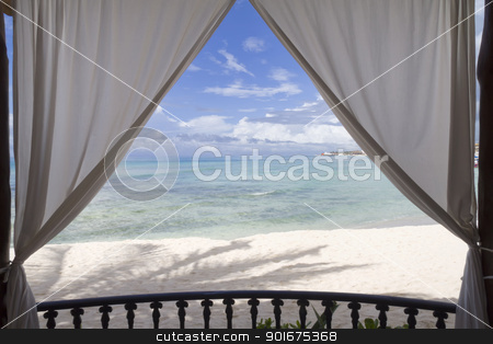 Framed Beach View stock photo, A framed view of the beach and tropical ocean by Kevin Tietz