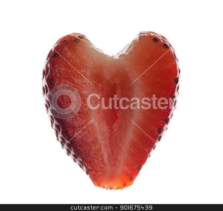 Fresh sliced strawberry in heart shape stock photo, Freshly sliced strawberry in shape of heart isolated against white by Steven Heap