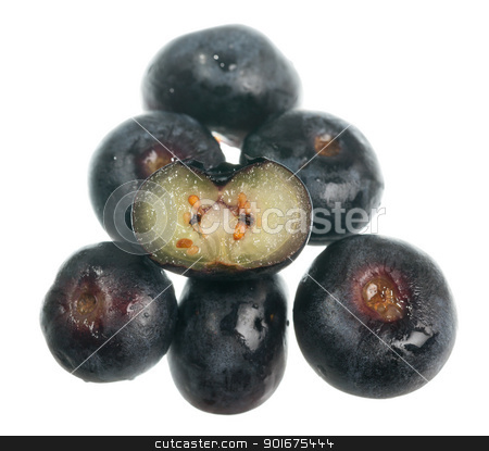 Fresh sliced blueberries stock photo, Stack of blueberries with one sliced through the center to show seeds by Steven Heap