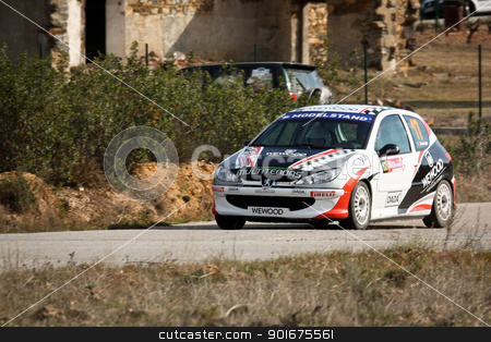 CASTELO BRANCO, PORTUGAL - MARCH 10: Salvador Gonzaga drives a Peugeot 206 GTI during Rally Castelo Branco 2012, integrated on Open Championship in Castelo Branco, Portugal on March 10, 2012. stock photo, CASTELO BRANCO, PORTUGAL - MARCH 10: Salvador Gonzaga drives a Peugeot 206 GTI during Rally Castelo Branco 2012, integrated on Open Championship in Castelo Branco, Portugal on March 10, 2012. by Paulo M.F. Pires