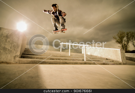 Skateboard ollie stock photo, Skateboarder jumping over the stairs on a big ollie. by Homydesign