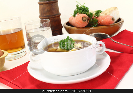 Beef consomme stock photo, Beef consomme with greens, egg and parsley by Maren Wischnewski