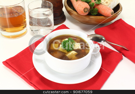 fresh Beef consomme stock photo, fresh Beef consomme with greens, egg and parsley by Maren Wischnewski