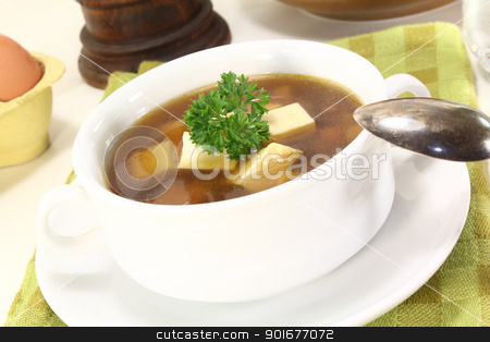 Beef consomme with egg stock photo, Beef consomme with greens, egg and fresh parsley by Maren Wischnewski