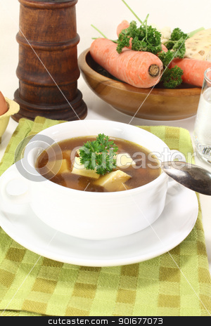 Beef consomme with parsley stock photo, Beef consomme with soup vegetables, egg and parsley by Maren Wischnewski