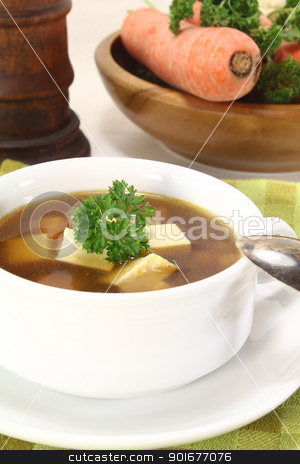Beef consomme with greens stock photo, Beef consomme with fresh soup vegetables, egg and parsley by Maren Wischnewski